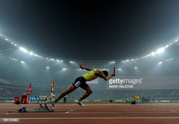 Ganbold Jansandorj of Mongolia starts the Mens 4x400m Relay Final in heavy pollution during the East Asian Games held at the Tianjin Olympic Center...