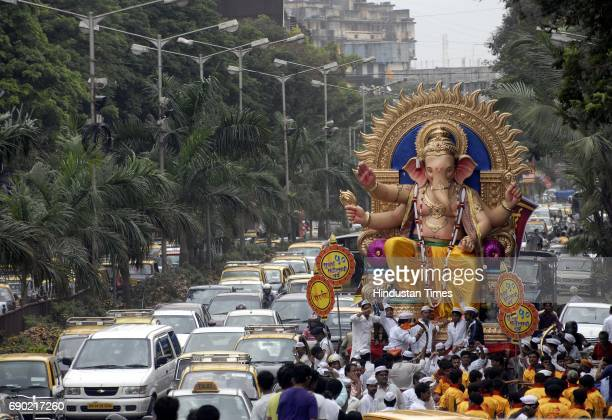 HT A ganesh idol of the 5th lane Kamathipura being taken in a procession from Lalbaug ahead of Ganesh Chaturthi which falls on 1st September 2011