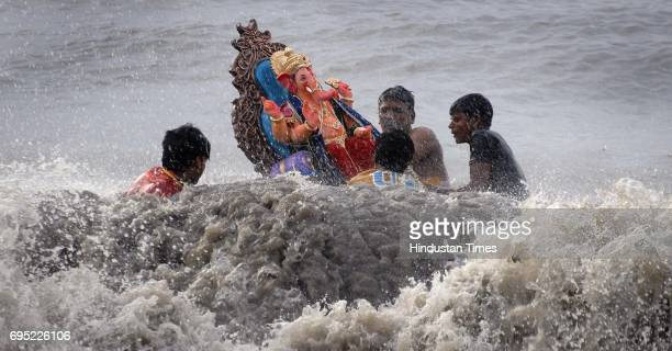 Ganesh immersion takes place on day 5 of the Ganpati Festival at Shivaji Park Beach Dadar