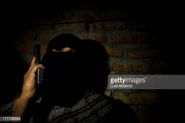 A gang member guards on a street at the Siloe neighborhood in Cali Colombia on June 27 2013 Siloe is one of the most dangerous neighborhoods of the...