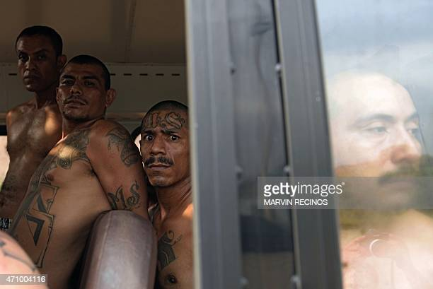 Gang members are seen inside a bus as they are transferred to a highsecurity prison on April 24 2015 in Izalco El Salvador About 400 feared gang...