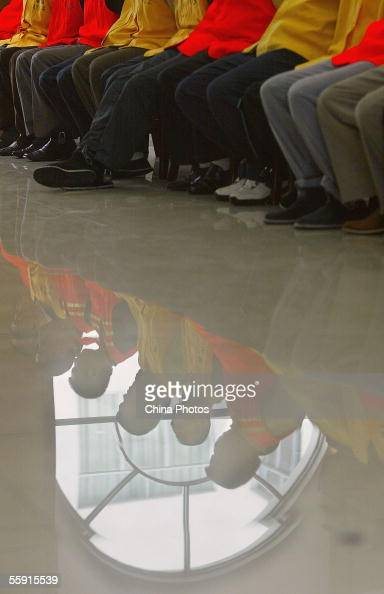 Gang members listen to sentence during a trial at the Meishan Intermediate People's Court on October 12 2005 in Meishan of Sichuan Province southwest...