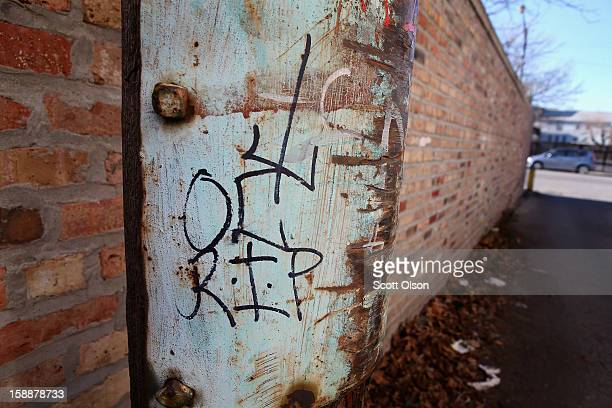 Gang symbols along with R I P is scrawled on a power pole in an alley near the spot where 20yearold Octavius Dontrell Lamb was shot yesterday and...