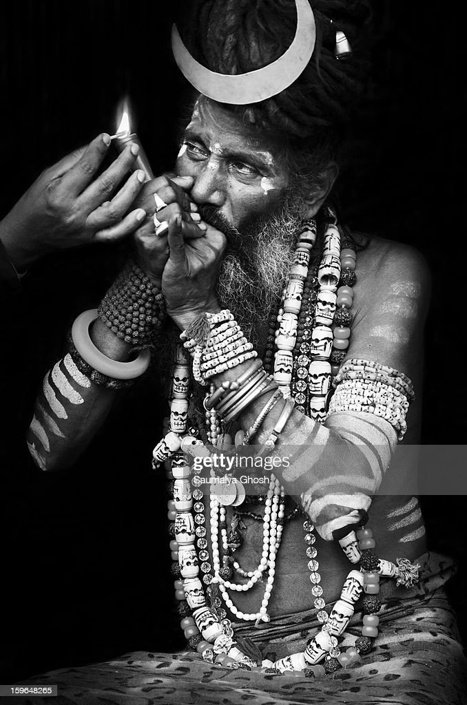 CONTENT] Gangasagar pilgrimage and fair is the second largest congregation of mankind after the holy Kumbha Mela. Millions of pilgrims from all over India come for a holy dip on Makar Sankranti. In the fair, one sadhu is enjoying his chillum.