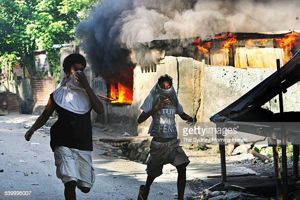 Gangs and vandals armed with machetes and slingshots patrol East Timor's capital Dili Many buildings in the city have been set alight as the country...