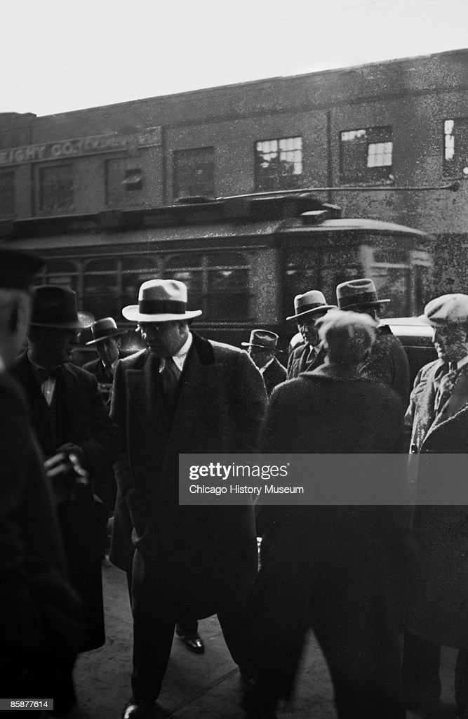 Gangster Al Capone walks through a group of men on a sidewalk Chicago ca1920s From the Chicago Daily News collection