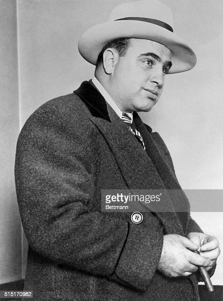 Gangster Al Capone wearing an overcoat in Chicago