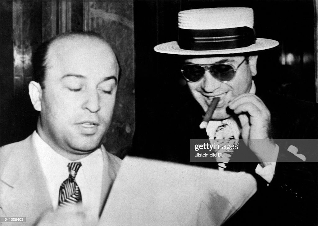 US gangster bosser <a gi-track='captionPersonalityLinkClicked' href=/galleries/search?phrase=Al+Capone&family=editorial&specificpeople=93051 ng-click='$event.stopPropagation()'>Al Capone</a> and his attorney Teitelbaum. 1931