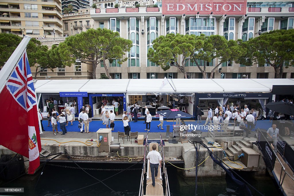 Gangways are seen leading to the quayside as visitors look at trade stands during the Monaco Yacht Show (MYS) in Monaco, France, on Thursday, Sept. 26, 2013. Over 100 of the world's luxury yachts will be displayed in Port Hercules during the 23rd MYS which runs from Sept. 25 - 28. Photographer: Balint Porneczi/Bloomberg via Getty Images