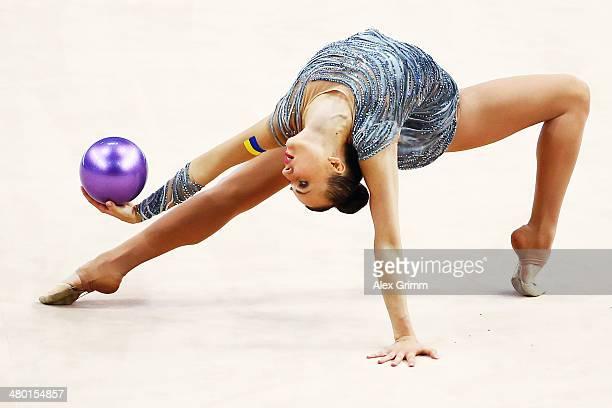 Ganna Rizatdinova of Ukraine performs during the individual ball final of the GAZPROM World Cup Rhythmic Gymnastics 2014 at the Porsche Arena on...