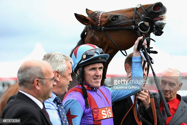 Gannicus and A P McCoy pose for a picture after victory in the Clipper Logistics Leger Legends Stakes at Doncaster Racecourse on September 9 2015 in...