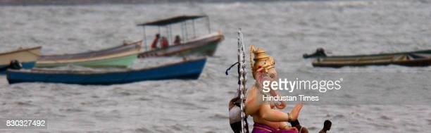 Ganpati Visarjan Devotees carry a statue of Ganesh Idol for immersion in the sea in Mumbai