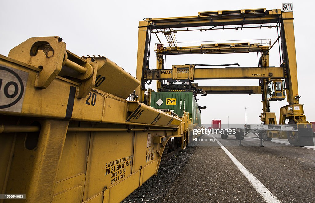 A gantry crane loads a shipping container onto a rail car at Union Pacific Corp.'s facility at the Port of Oakland in Oakland, California, U.S., on Wednesday, Jan. 23, 2013. Union Pacific Corp., the largest U.S. railroad by sales, is scheduled to report fourth-quarter earnings results on Jan. 24 before the opening of U.S. financial markets. Photographer: Ken James/Bloomberg via Getty Images