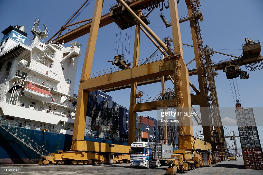 A gantry crane operates as shipping containers are loaded onto cargo vessel Santa Bettina operated by Reederei ClausPeter Offen GmbH at Thessaloniki...