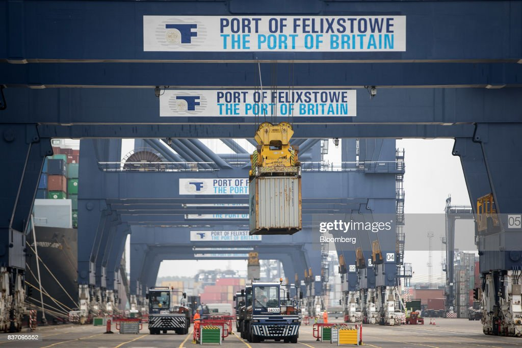 A gantry crane transports a shipping container from the Maersk Madrid cargo ship, operated by A.P. Moller-Maersk A/S, at the Port of Felixstowe Ltd., a subsidiary of CK Hutchison Holdings Ltd. in Felixstowe, U.K., on Tuesday, Aug. 22, 2017. U.K. exporters are still reaping the benefits of a weaker pound, but they're not sure how long the boost will continue as the country gets closer to withdrawing from the European Union. Photographer: Simon Dawson/Bloomberg via Getty Images