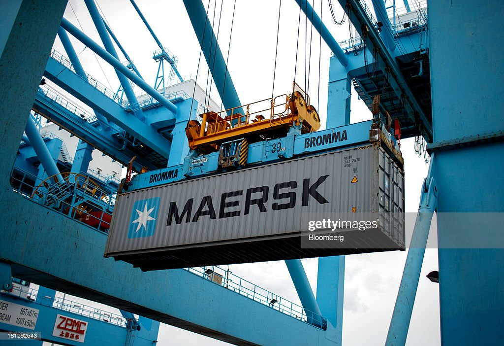 A gantry crane transports a shipping container from the vessel Maersk Seoul, operated by AP Moeller-Maersk A/S, at the APM Terminal in the Port of Rotterdam, in Rotterdam, Netherlands, on Thursday, Sept. 19, 2013. The pace of economic contraction in the Netherlands, which is in its third recession in five years, is slowing. Photographer: Jasper Juinen/Bloomberg via Getty Images