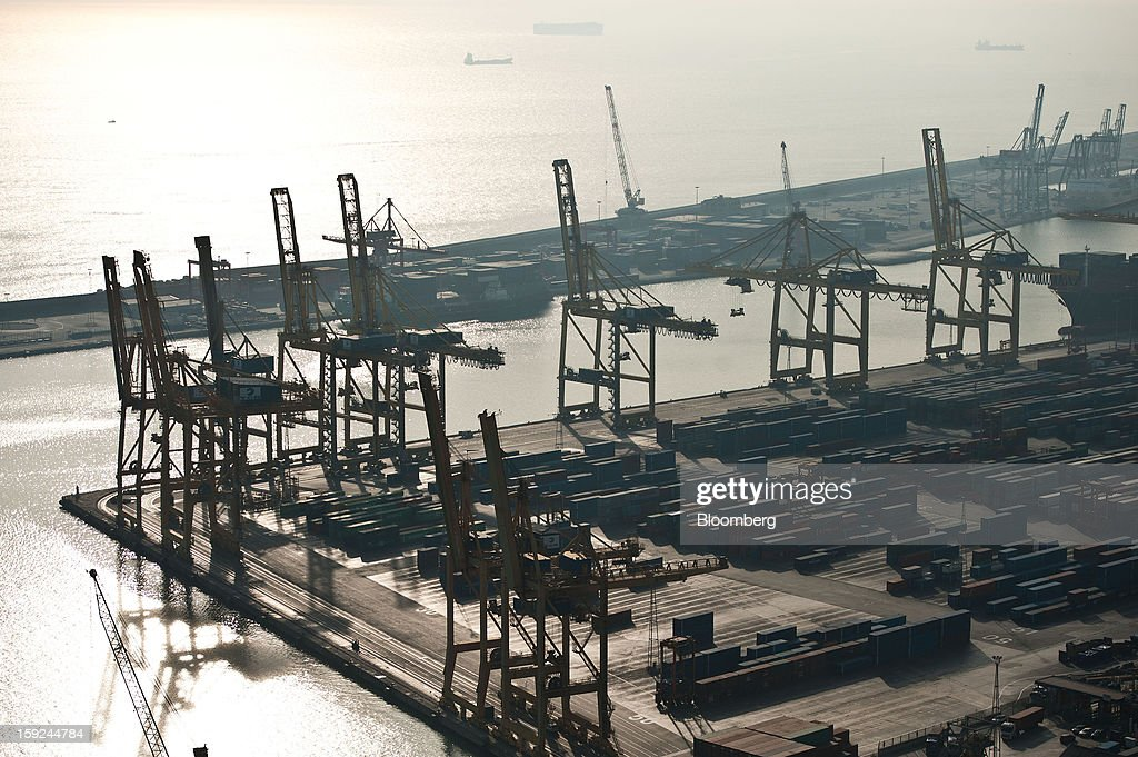 Gantry cranes and shipping containers stand at Barcelona port in Barcelona, Spain, on Thursday, Jan. 10, 2013. Spanish exports grew the least in five months in September as the euro area relapsed into a recession and the region's fourth-largest economy continued to contract. Photographer: David Ramos/Bloomberg via Getty Images