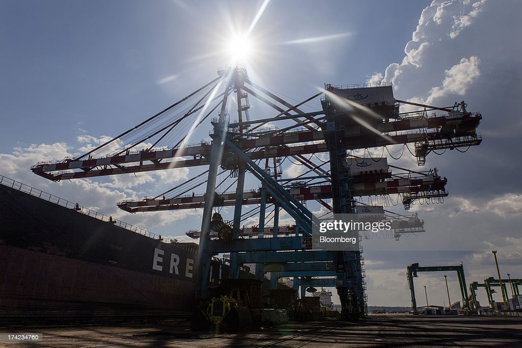 Gantry cranes load coal onto a cargo ship for export in Yuzhny port, operated by TIS Group, near Odessa, Ukraine, on Friday, July 19, 2013. Ukraine wants to cut current-account deficit to 3%-4% of GDP in medium term, central bank official Serhiy Nikolaychuk tells reporters in Kiev. Photographer: Vincent Mundy/Bloomberg via Getty Images