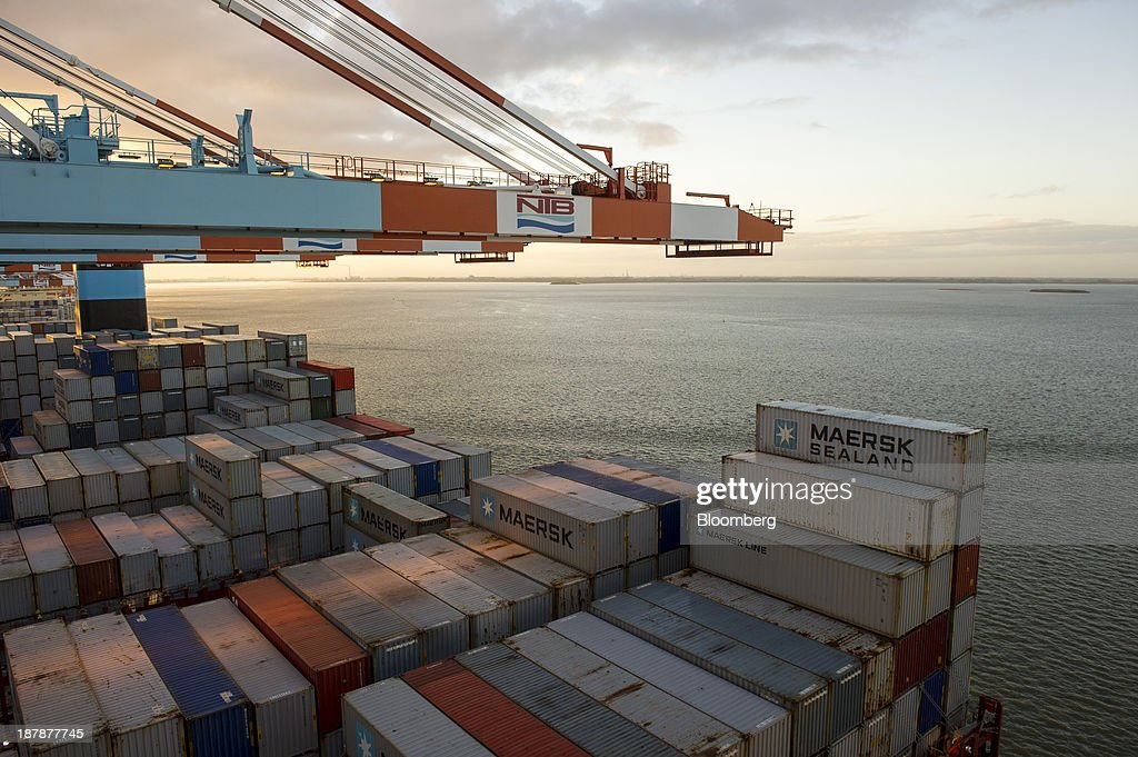Gantry cranes operate above shipping containers on the deck of the Maersk Mc-Kinney Moeller Triple-E Class container ship, operated by A.P. Moeller-Maersk A/S, during loading operations at the Port of Bremerhaven in Bremerhaven, Germany, on Monday, Nov. 11, 2013. A.P. Moeller-Maersk A/S's container-shipping line, the world's largest, reported an 11 percent increase in third-quarter profit after cost cuts countered a decline in freight rates. Photographer: Kristian Helgesen/Bloomberg via Getty Images