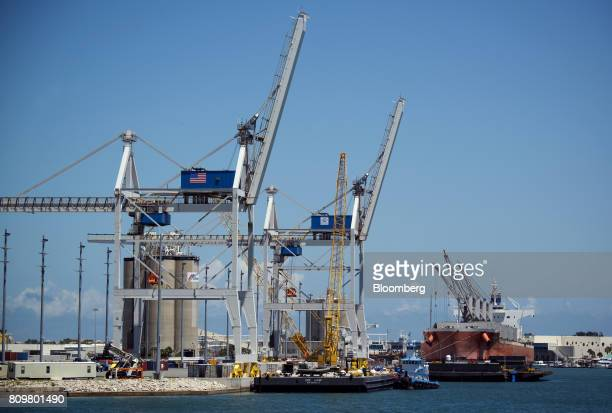 Gantry cranes stand at Port Canaveral in Cape Canaveral Florida US on Wednesday July 5 2017 The US Census Bureau released trade balance of goods and...