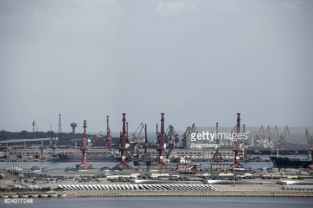 Gantry cranes stand in the port facility in Qinhuangdao China on Friday Oct 28 2016 Chinas efforts to quell surging coal prices showed signs theyre...