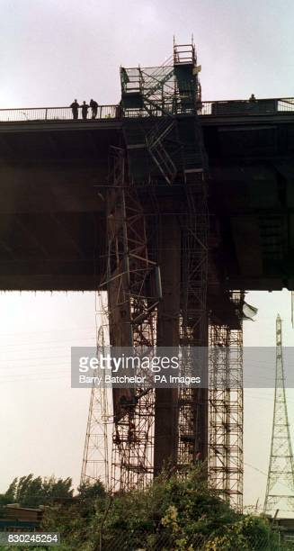 A gantry platform hangs from the underside of Avonmouth Bridge that carries the M5 motorway near Bristol Four workmen plunged to their death from the...
