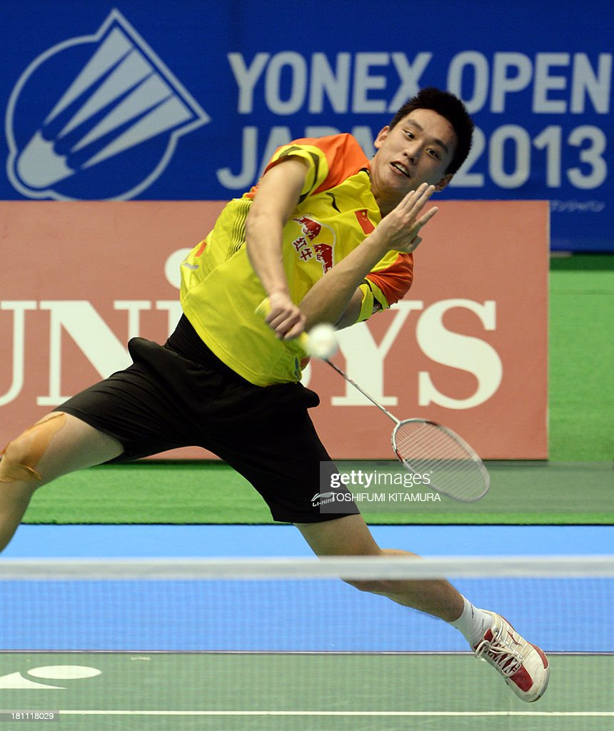 Gao Huan of China hits a smash during his men s singles second