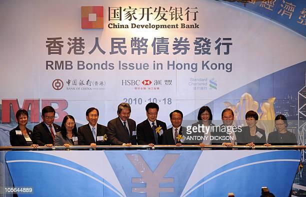 Gao Jian executive vice president of the China Development Bank and John Tsang Hong Kong Financial Secretary along with other delegates attend a bond...