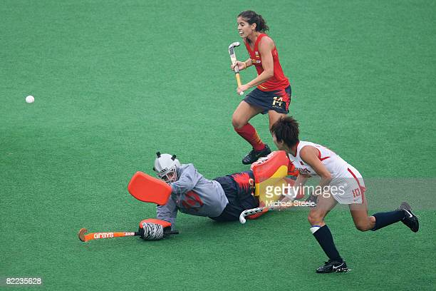 Gao Lihua of China shoots past goalkeeper Maria Lopez De Eguilaz of Spain during the women's hockey match between China and Spain held at the Beijing...