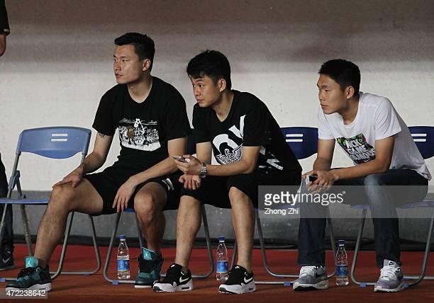 Gao Lin and Liu Jian of Guangzhou Evergrande watch the match on the bench during the AFC Asian Champions League match between Guangzhou Guangzhou...