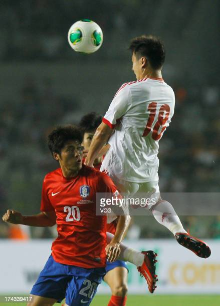 Gao Lin of China and Hwang SeokHo of South Korea battle for the ball during the EAFF East Asian Cup match between Korea Republic and China at...