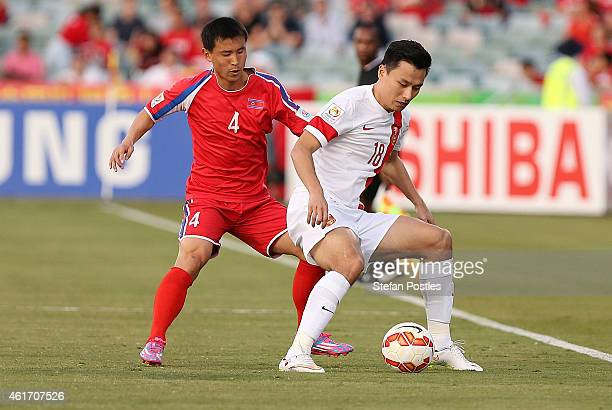 Gao Lin of China and Jon Kwang Ik of DPR Korea contest possession during the 2015 Asian Cup match between China PR and DPR Korea at Canberra Stadium...