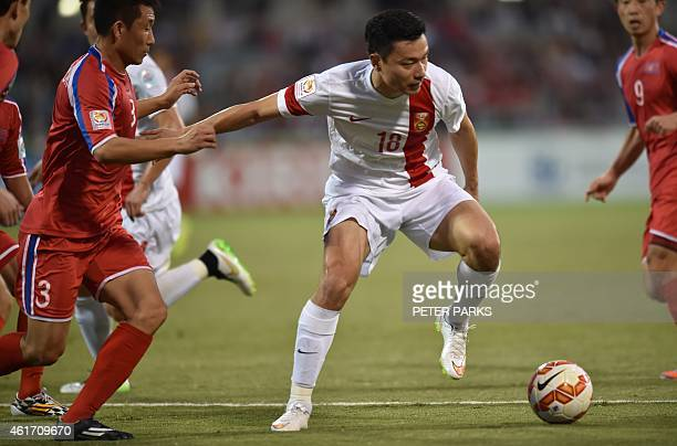 Gao Lin of China fights for the ball with Jang Song Hyok of North Korea during their Group B football match at the AFC Asian Cup in Canberra on...