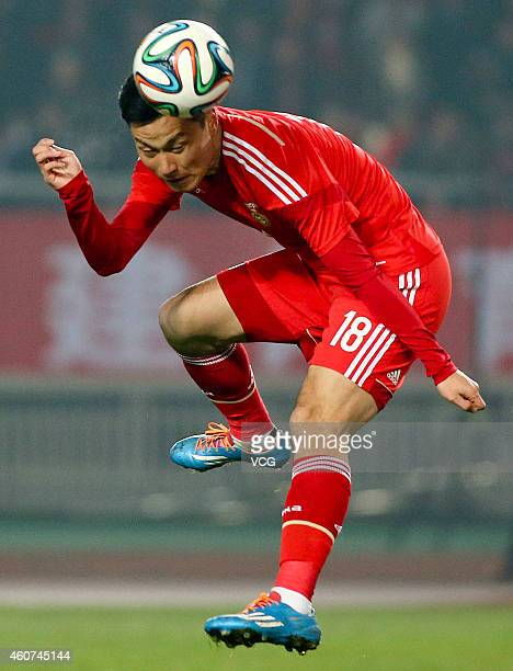 Gao Lin of China jumps to head the ball during the International Friendly Match between China and Palestine at Chenzhou Sports Center on December 21...
