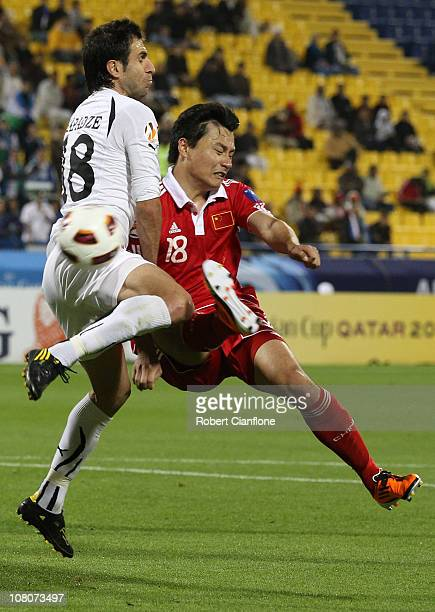 Gao Lin of China PR and Timur Kapadze of Uzbekistan challenge each other for the ball during the AFC Asian Cup Group A match between China PR and...