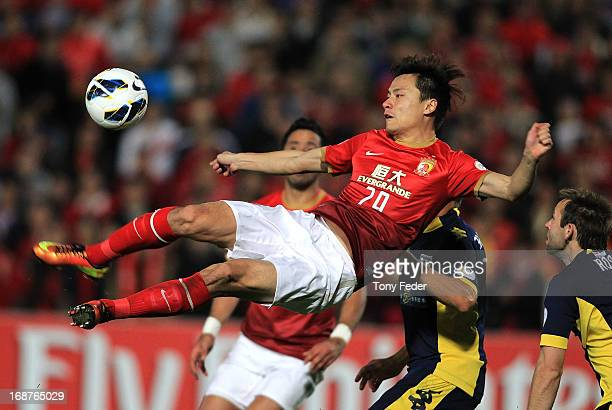 Gao Lin of Evergrande heads the ball during the AFC Asian Champions League match between the Central Coast Mariners and Guangzhou Evergrande at...