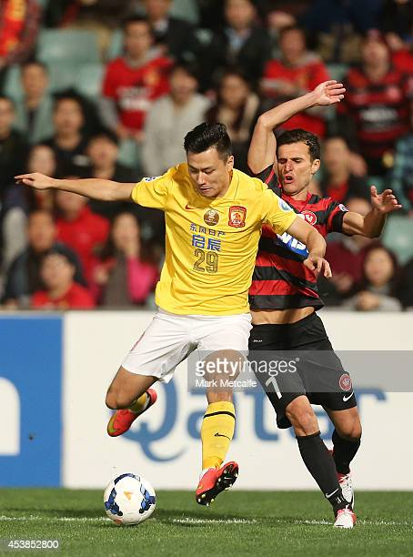 Gao Lin of Evergrande is challenged by Labinot Haliti of the Wanderers during the Asian Champions League Final match between the Western Sydney...