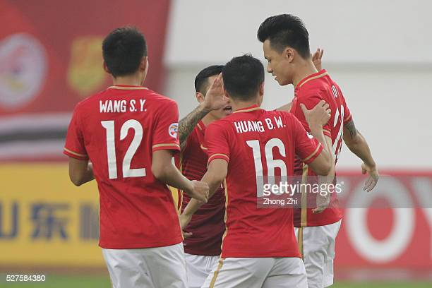 Gao Lin of Guangzhou Evergrande celebrates his goal with teammates during the AFC Asian Champions League match between Guangzhou Evergrande FC and...