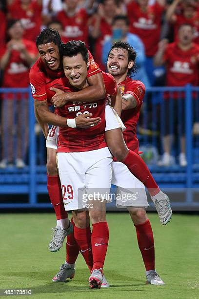 Gao Lin of Guangzhou Evergrande celebrates with Paulinho and Ricardo Goulart after scoring his team's third goal during the AFC Champions League...