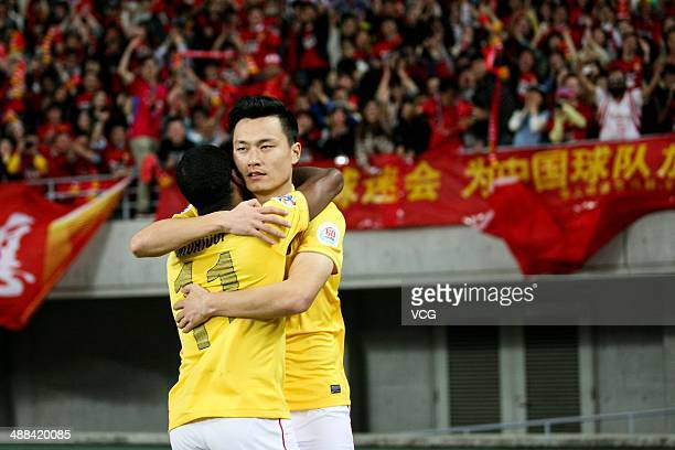 Gao Lin of Guangzhou Evergrande celebrates with team mate Muriqui after scoring his team's fourth goal during the AFC Asian Champions League 2014...