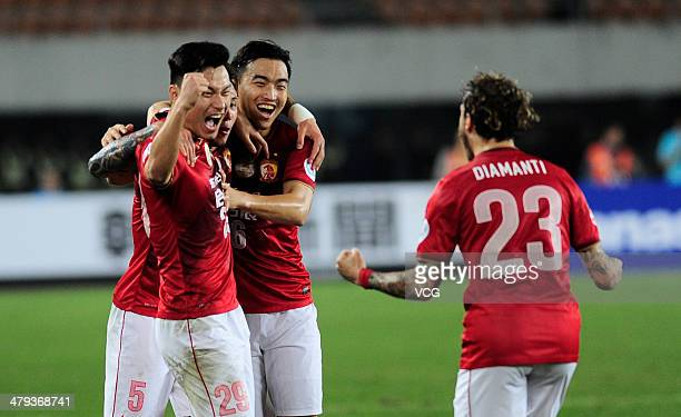 Gao Lin of Guangzhou Evergrande celebrates with team mates after scoring his team's first goal during the AFC Asian Champions League match between...