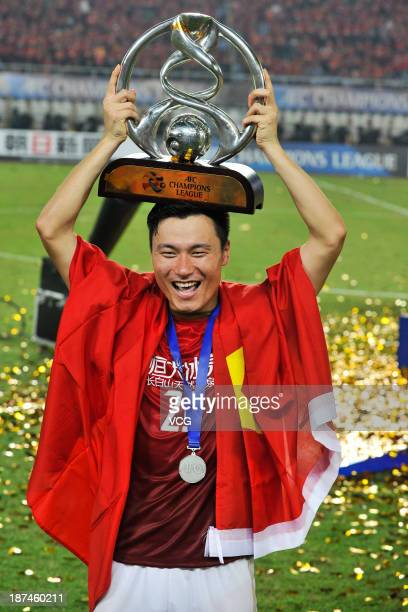 Gao Lin of Guangzhou Evergrande celebrates with the trophy after winning the AFC Champions League Final 2nd leg match against FC Seoul at Tianhe...