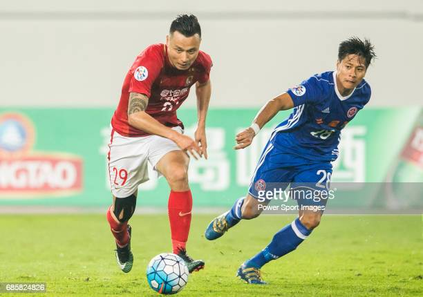 Gao Lin of Guangzhou Evergrande FC runs past Wong Chi Chung of Eastern SC during their AFC Champions League 2017 Match Day 1 Group G match between...