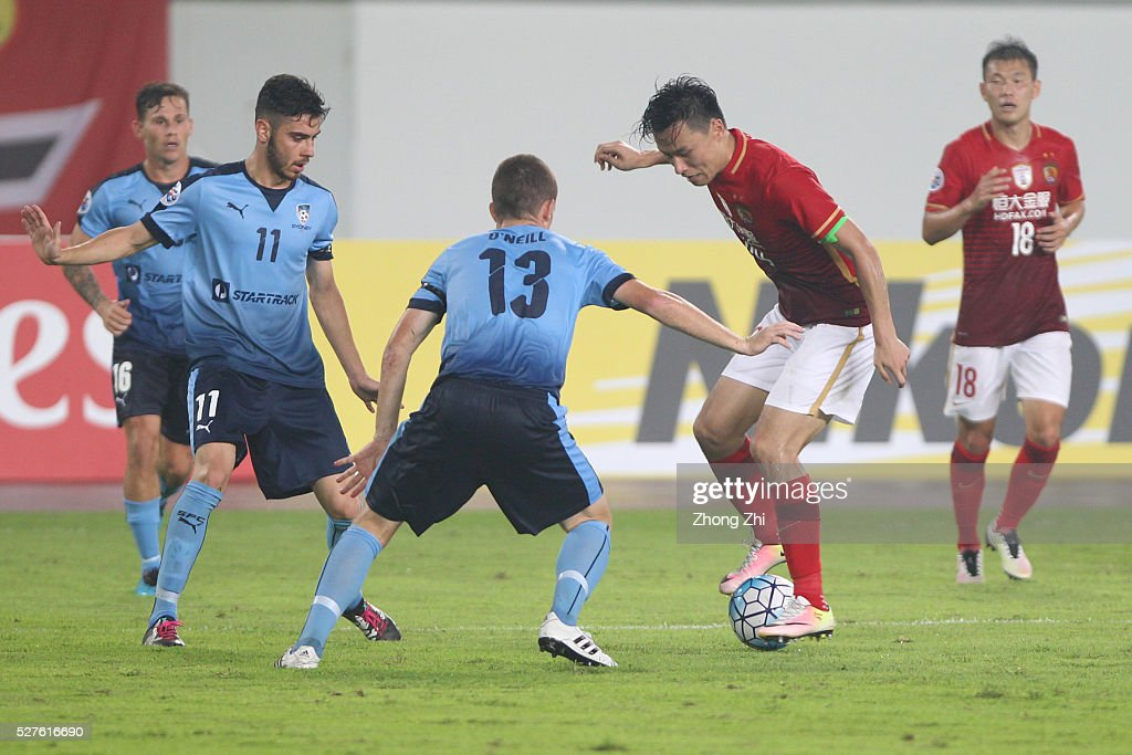 Gao Lin of Guangzhou Evergrande in action against Christopher Naumoff, Brandon O'Neill of Sydney FC during the AFC Asian Champions League match between Guangzhou Evergrande FC and Sydney FC at Tianhe Stadium on May 3, 2016 in Guangzhou, China.