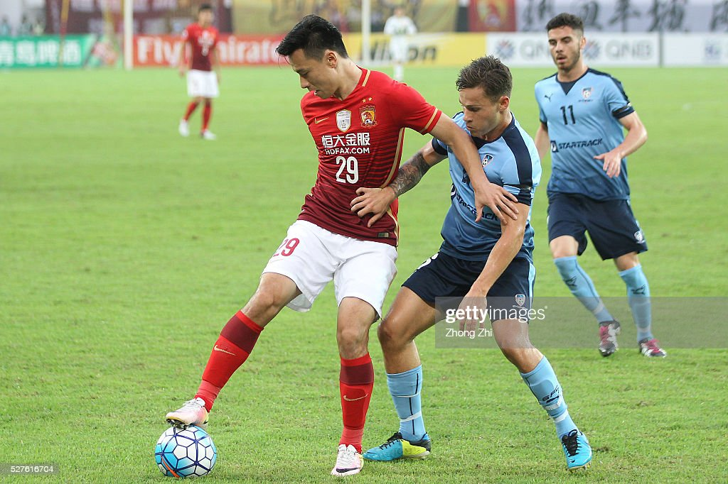 Gao Lin of Guangzhou Evergrande in action against Riley Paul Woodcock of Sydney FC during the AFC Asian Champions League match between Guangzhou Evergrande FC and Sydney FC at Tianhe Stadium on May 3, 2016 in Guangzhou, China.