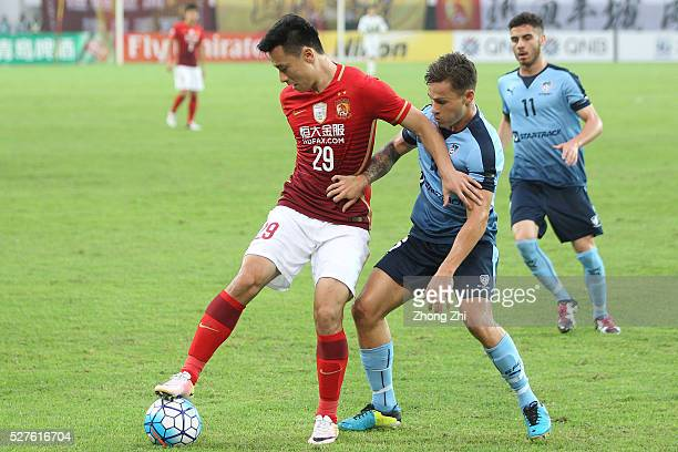 Gao Lin of Guangzhou Evergrande in action against Riley Paul Woodcock of Sydney FC during the AFC Asian Champions League match between Guangzhou...