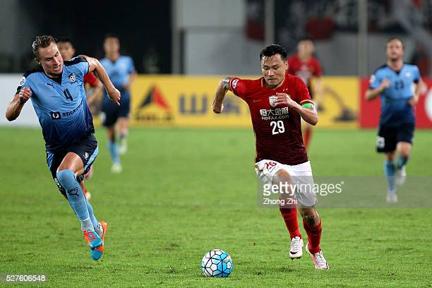 Gao Lin of Guangzhou Evergrande in action against Zac Anderson of Sydney FC during the AFC Asian Champions League match between Guangzhou Evergrande...