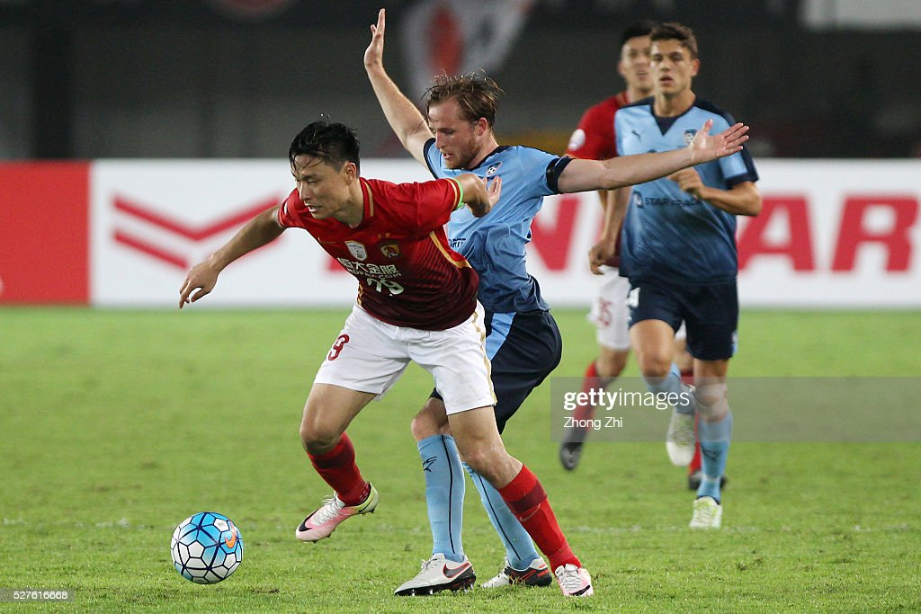 Gao Lin of Guangzhou Evergrande in action against Zac Anderson of Sydney FC during the AFC Asian Champions League match between Guangzhou Evergrande FC and Sydney FC at Tianhe Stadium on May 3, 2016 in Guangzhou, China.