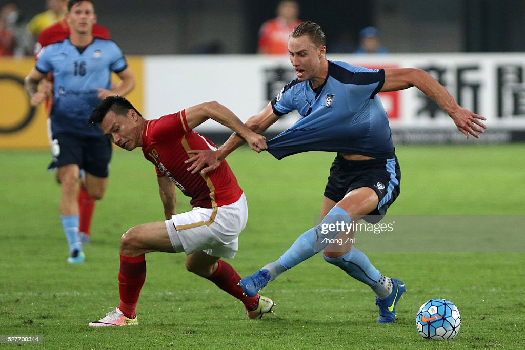<a gi-track='captionPersonalityLinkClicked' href=/galleries/search?phrase=Gao+Lin&family=editorial&specificpeople=590386 ng-click='$event.stopPropagation()'>Gao Lin</a> of Guangzhou Evergrande in action against Zac Anderson of Sydney FC during the AFC Asian Champions League match between Guangzhou Evergrande FC and Sydney FC at Tianhe Stadium on May 3, 2016 in Guangzhou, China.