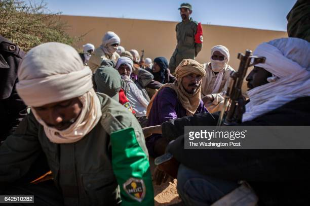 Gao Mali Members of former rebel groups part of the peace process wait to be registered in the MOC at a local police station in Gao Mali on Friday...